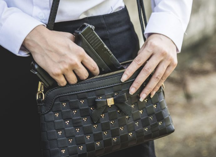 Woman concealed carry gun in purse